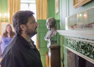 Visitor studying an artefact at the Treasurer's House, Yorkshire