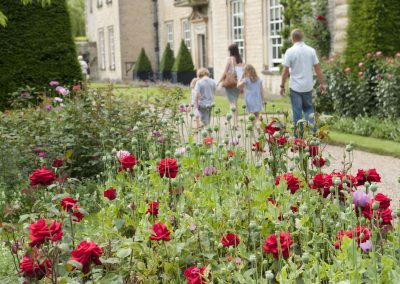 Family exploring the gardens at Nunnington Hall, North Yorkshire.