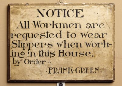 Notice on the stairs at Treasurer's House, York, with instructions for visiting workmen