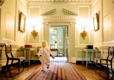 Girl running in the gallery at Ormesby Hall, Yorkshire